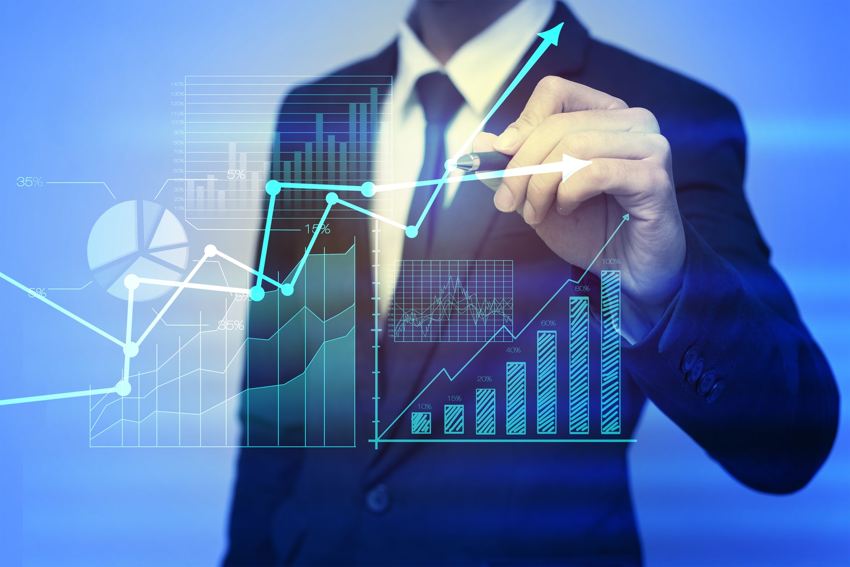Business man plotting point on a graph and charts showing growth